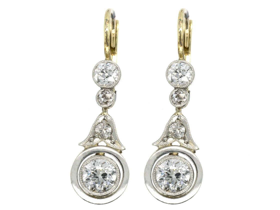 A really lovely pair of diamond earrings. The diamonds are brilliant white stones set in platinum on the front with 18ct gold behind. The fittings are hinge back which are very safe. They were made in Germany circa 1920-1930.