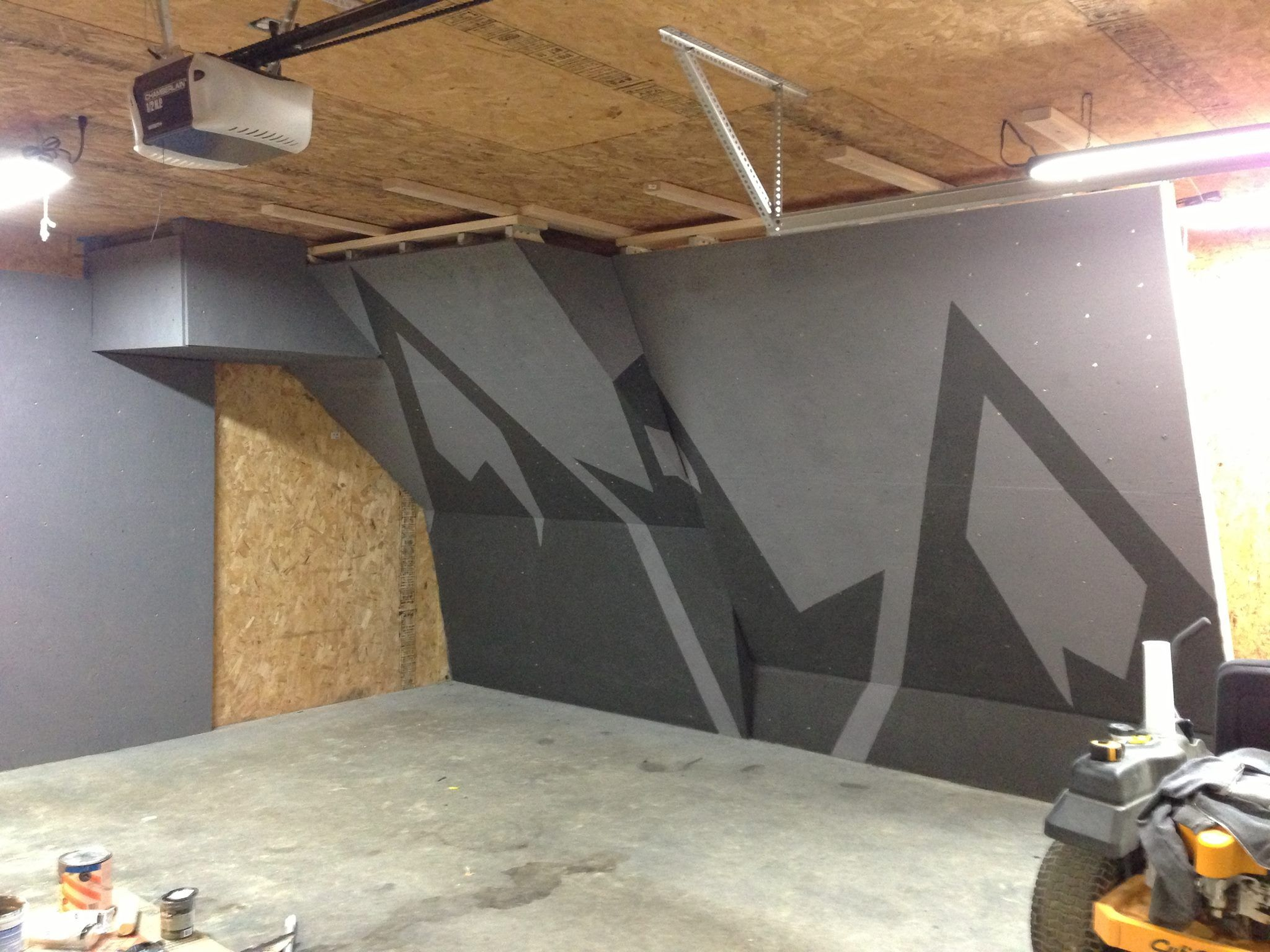 Awesome paint job home gym in home climbing wall