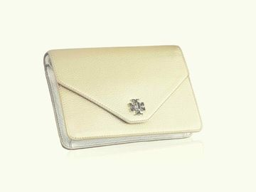 Beautiful Tory Burch Classic. The Kira Metalic Gold Cluctch features the iconic double-T logo that