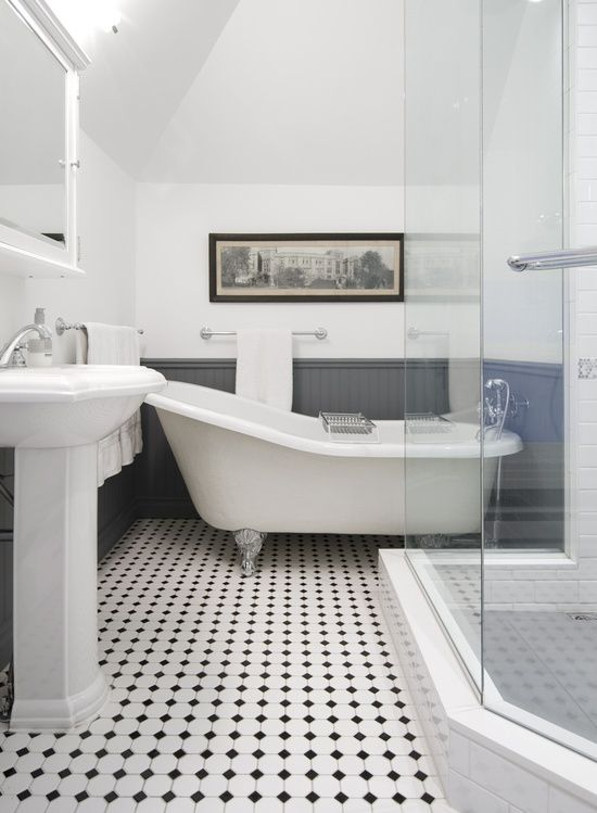 I like this take one the retro black and white tiled floor. Panelled bathroom, black and white tiled