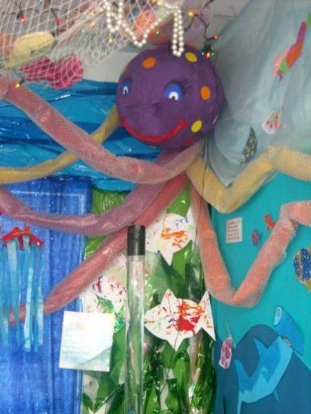Olly the octopus classroom ocean theme.  This would be great for my hallway!  Have a seashell with swizzle sticks for pointers!