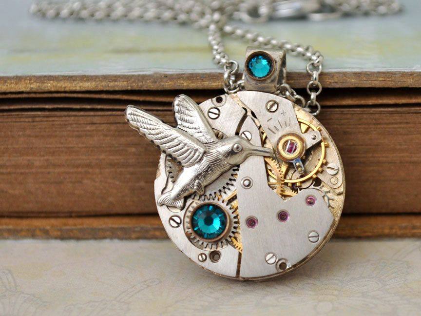 ENCHANTED FOREST steampunk watch movement necklace with humming bird and Swarovski rhinestones. $39.50, via Etsy.