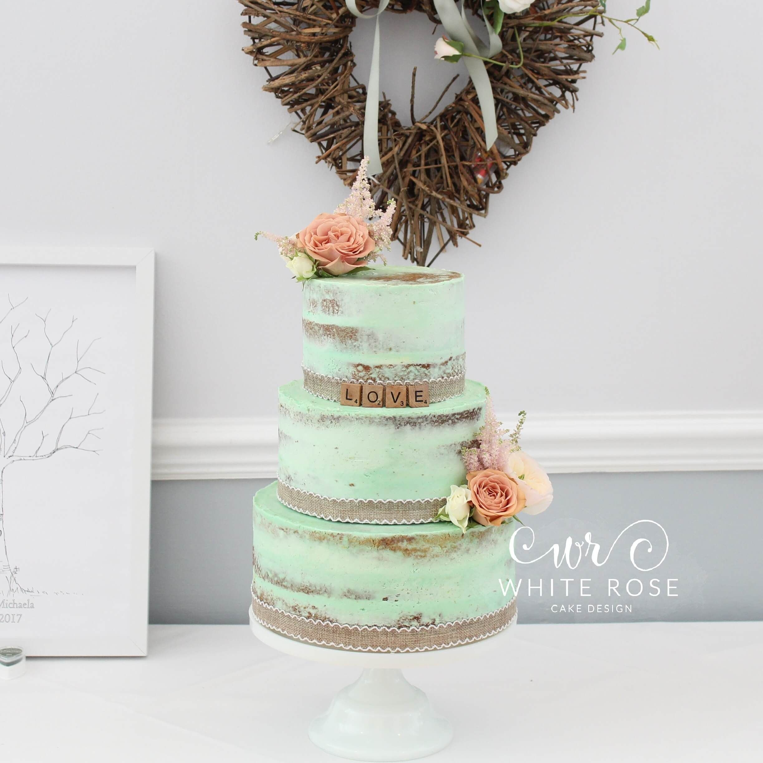 A Rustic Mint And Peach Wedding Cake Dressed With Fresh Flowers At Durker Roods Hotel