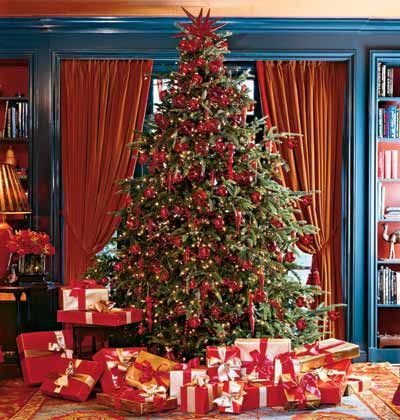 Nothing says #Christmas like an evergreen covered in scarlet-red decorations. Carry the festive color throughout your home with bold candles, decorative ribbon, and festive china.