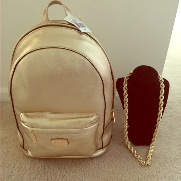 ... Gold Michael Kors backpack with gold rope chain Gold Michael Kors  backpack with gold plated rope ... 05ee606e46a20