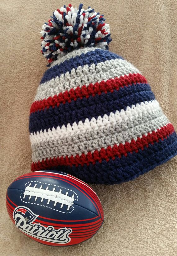 2109c38eafc A great hat for New England Patriots fans! Go Pat s Hat. Winter pompom hat