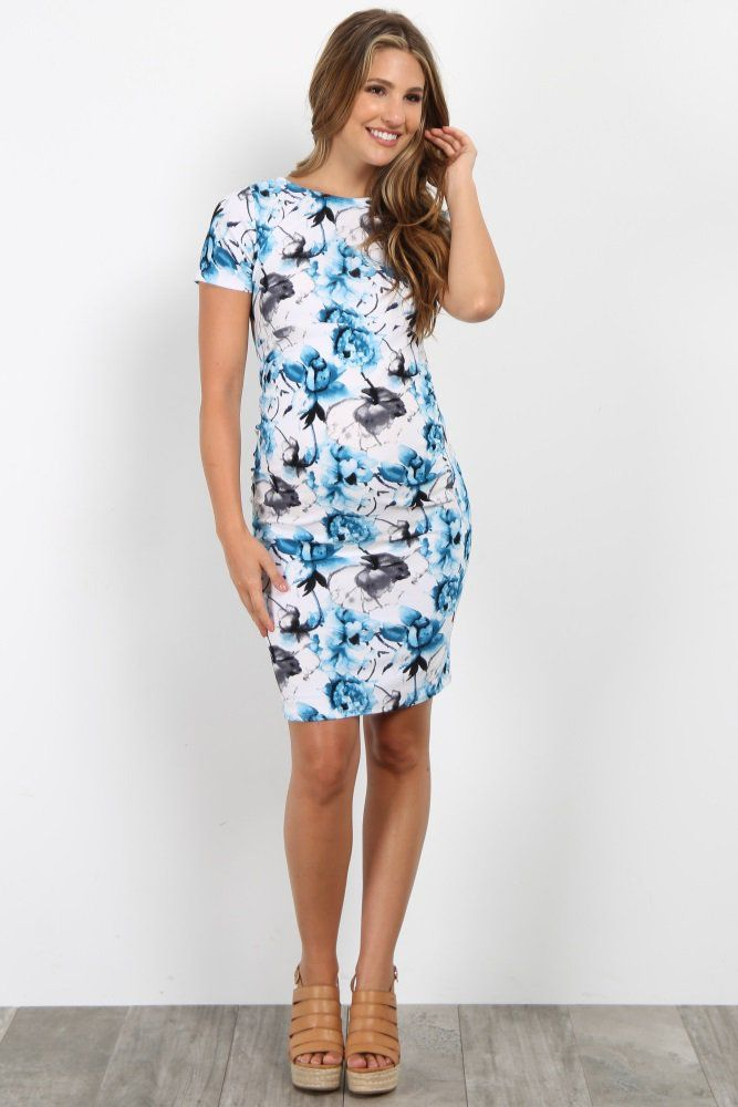 297e8d6cae993 Floral print short sleeve fitted maternity dress. Ruched sides. Rounded  neckline.