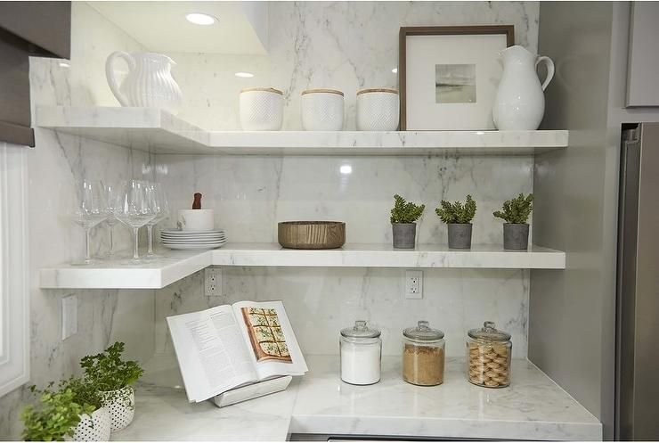 White Quartz Floating Shelves Are Stacked In An L Shape In