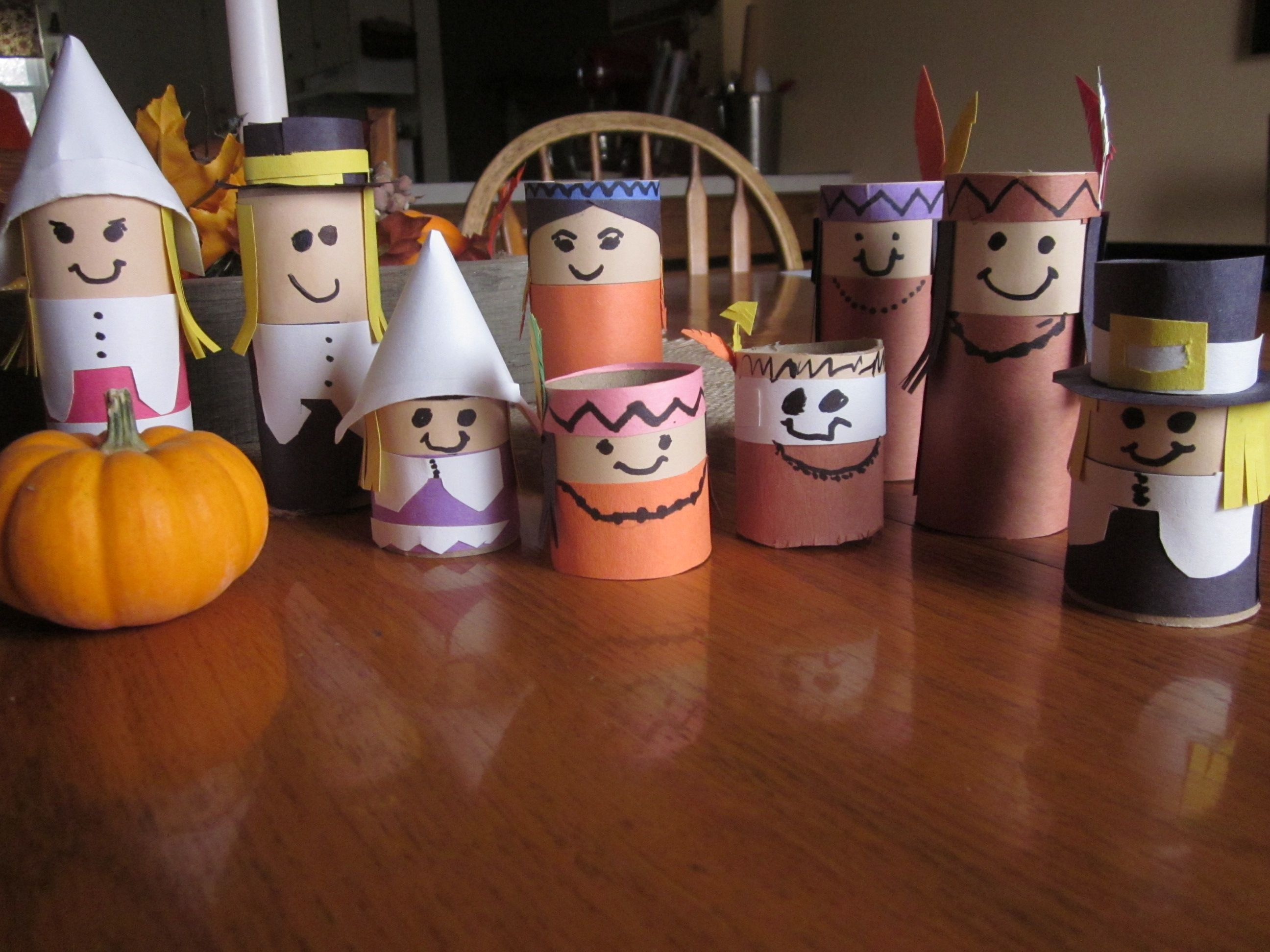 Pilgrims and Indians made from toilet paper tubes.