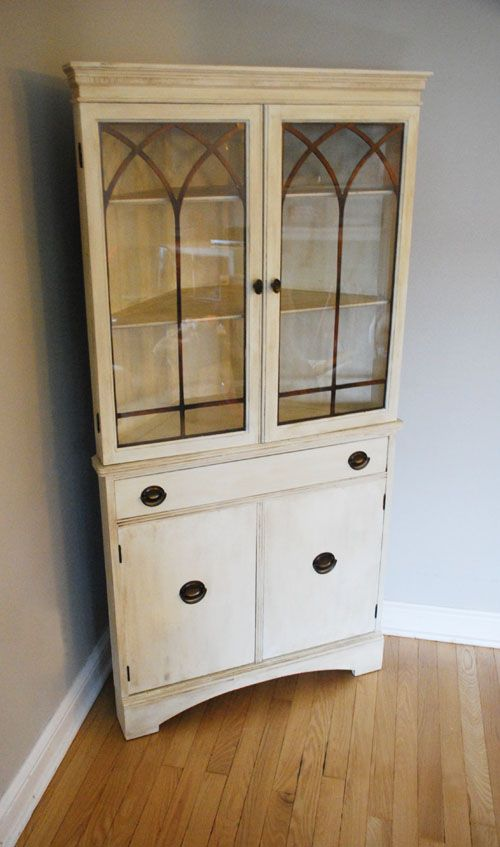 Corner Cupboard. Cabinet. Hutch. Pretty Glass Design. Would be nice in  kitchen. Show off blue glass. White with heavy antiquing - Detailing At The Top, Around The Doors, Open Windows - Similar