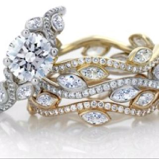 The De Beers Adonis Rose Diamond Engagement Ring with its three matching bands