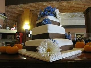 3 tier wedding cake, satin ribbon trim, accent flowers matched the brides bouquet.