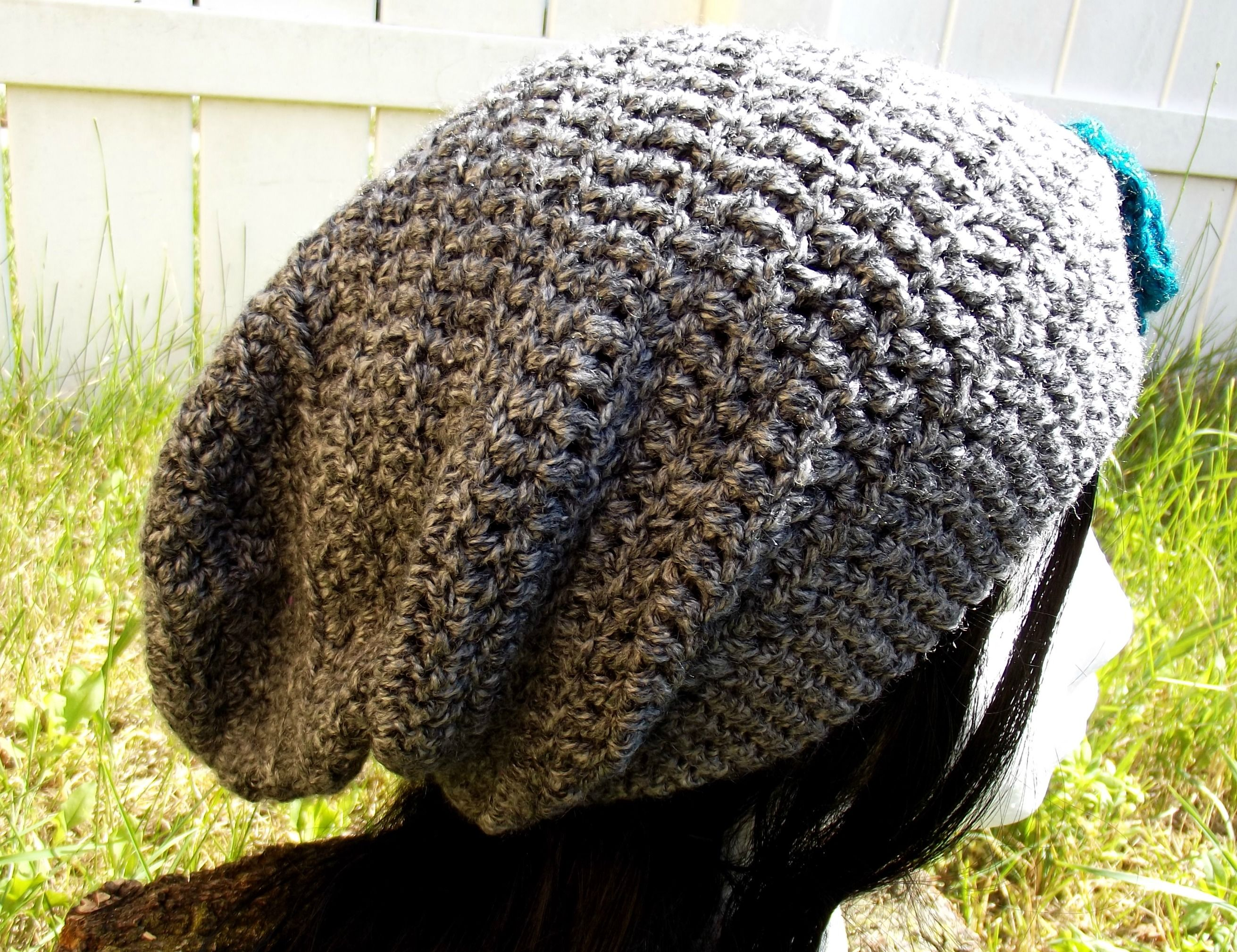 Black Heather. Great for any season this light weight super slouch hat is black, grey and white tweed. Flower is removable so it can be used as an accessory for anything. Available for order @ facebook.com/hooka.yarn