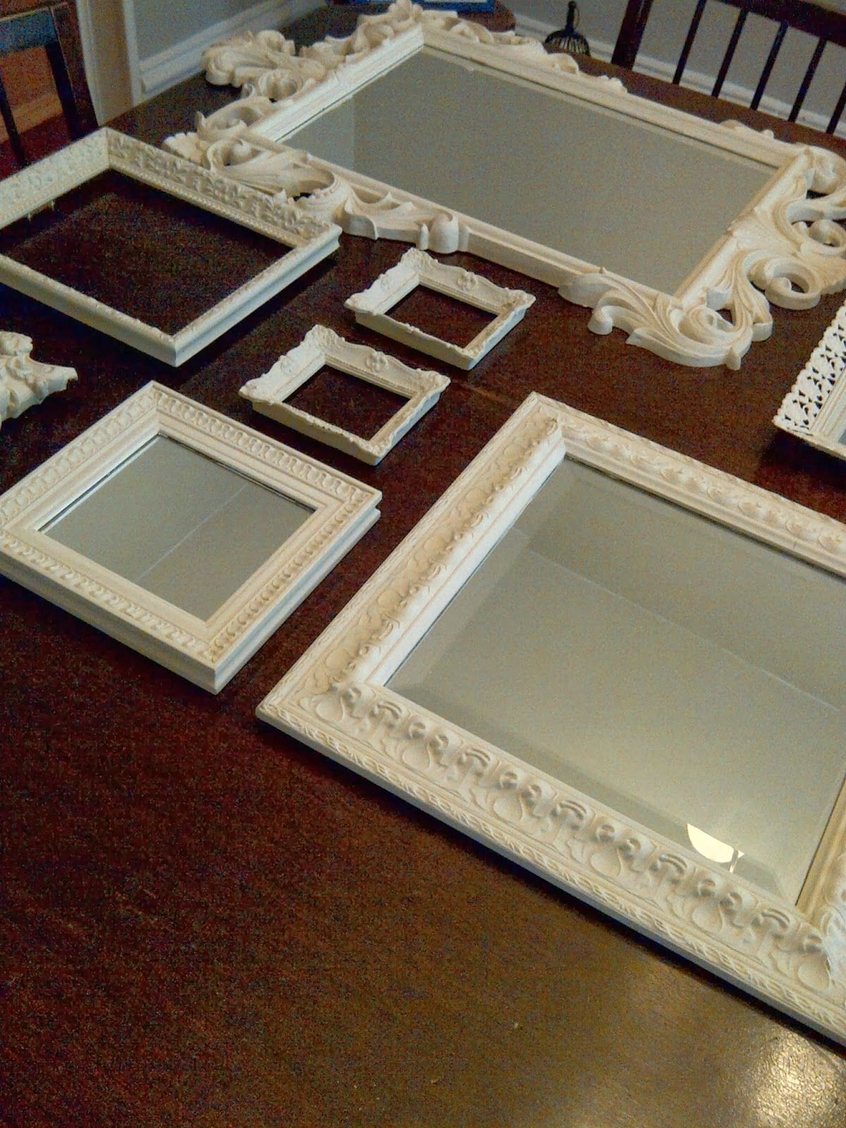 Mirror and frame gallery - you can paint all the frames the same colour to bring them all together!
