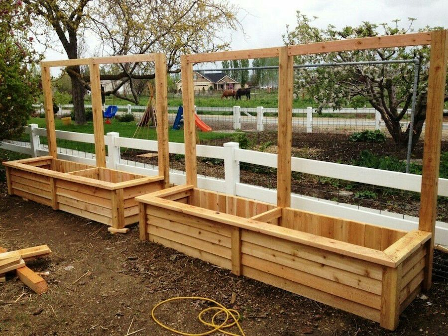 Used Hand Crafted cedar raised planter with wire for sale