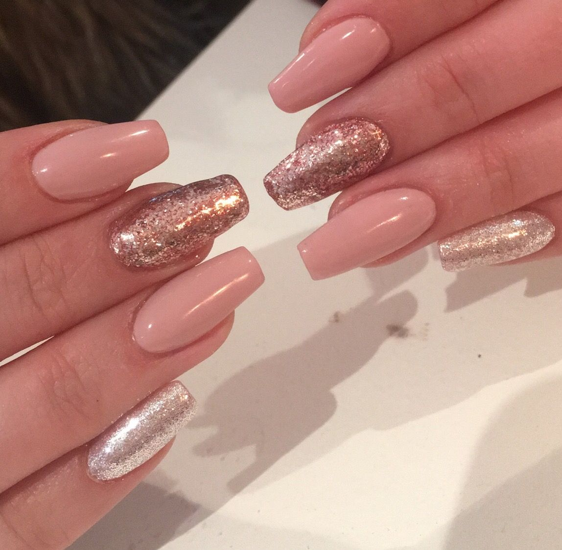 coffin shaped acrylic nails with nude pink, gold and silver