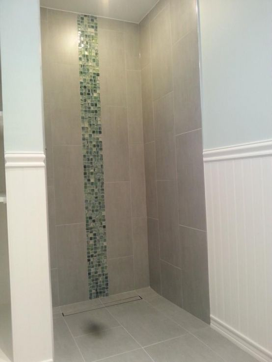 This bathroom features 12x24 Rhythm Nickel Porcelain tile on the