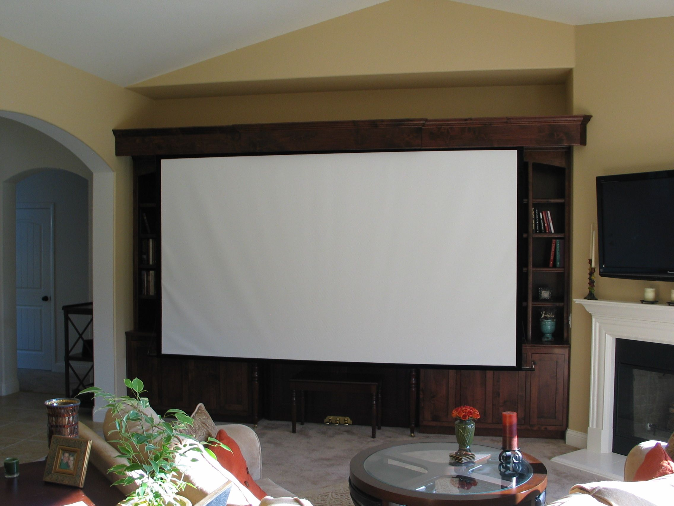 Giant Projector Screen In Entertainment Center Elderly Home Home Buying Living Room Remodel