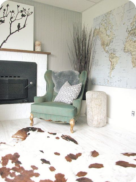 Beachy room with driftwood side table and map. Cowhide rug