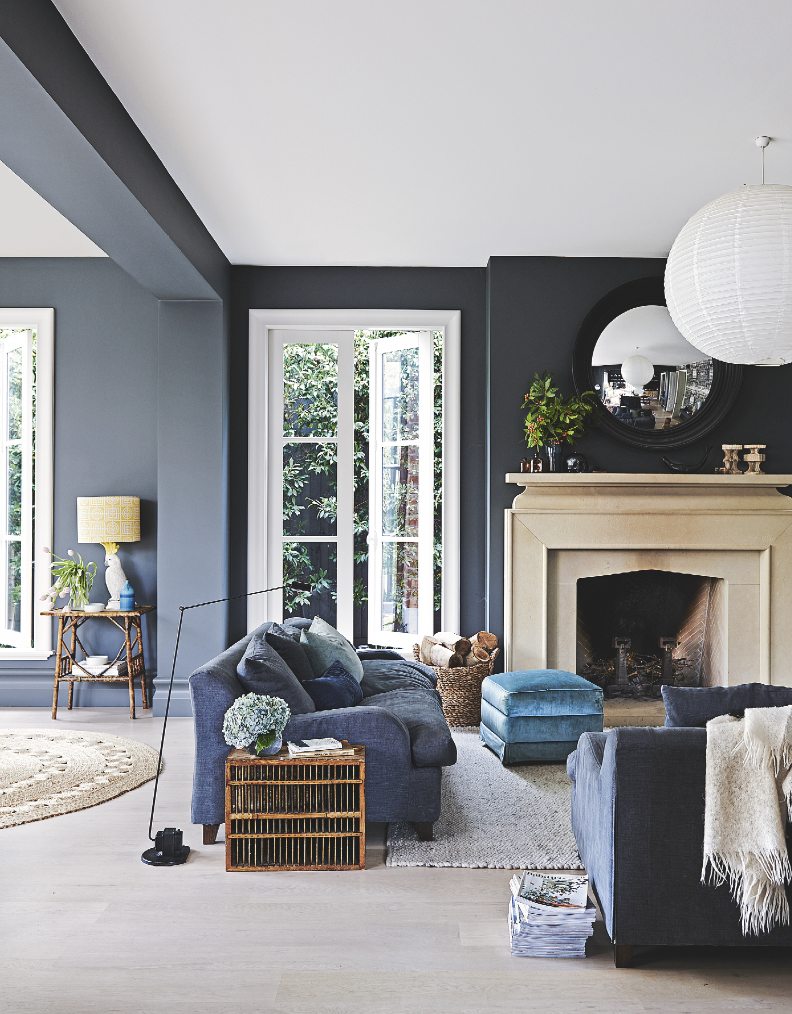 Rich Deep Dark Blue Walls In This Living Room Contrasted Against The White Ceiling And Taupe Fireplac Dark Grey Living Room Dark Living Rooms Black Living Room