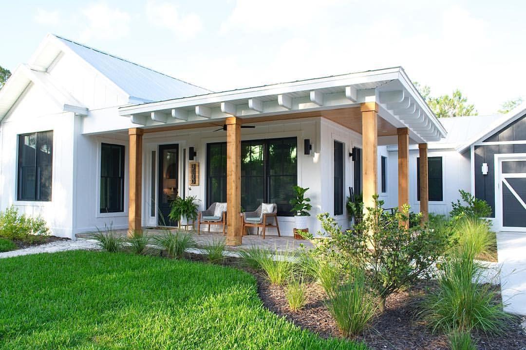 One-story white modern farmhouse exterior. Wraparound ...