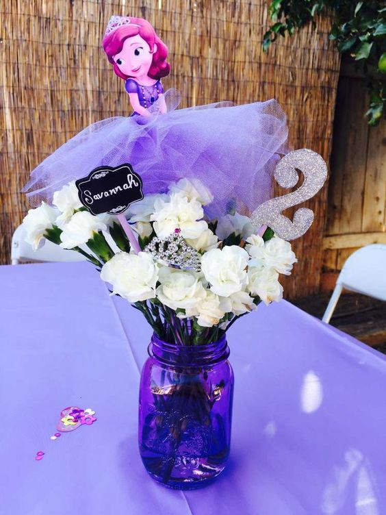 Purple mason jar centerpieces at a Sofia the First birthday party! See more party planning ideas at CatchMyParty.com!: