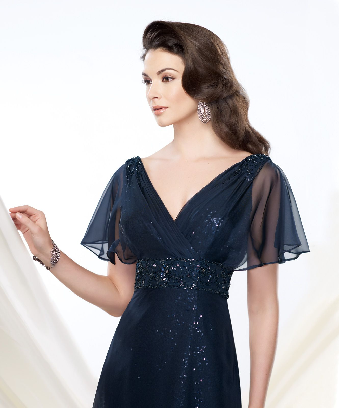 Chiffon over sequin aline dress features draped split flutter