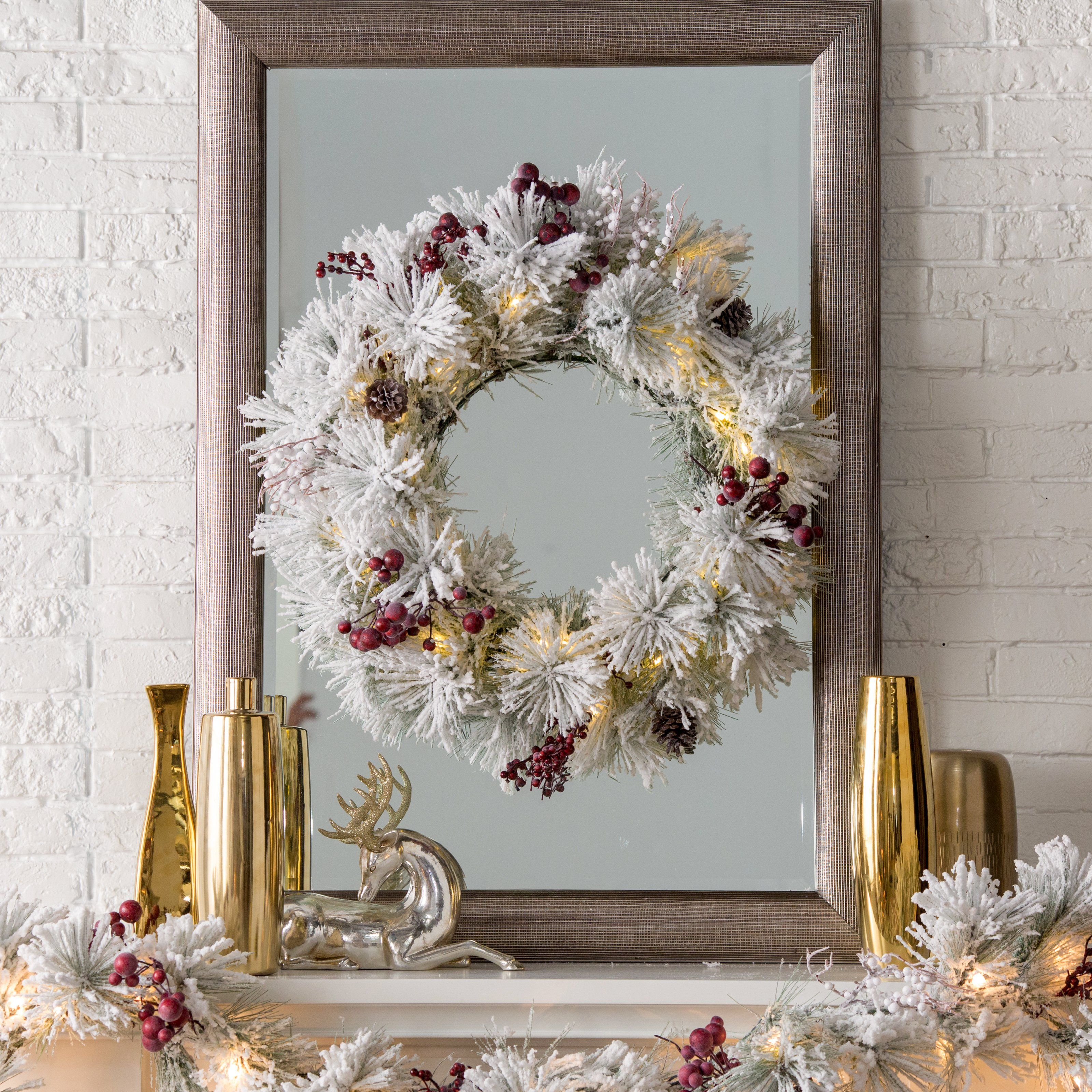 Belham Living Flocked Pine Needle 28 in. Pre-Lit Battery Operated Wreath with Berries and Pine Cones | from hayneedle.com
