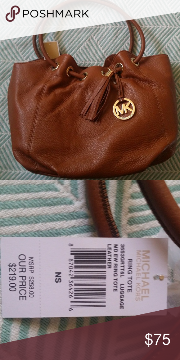 48103818e274 Michael Kors ring tote bag Michael Kors ring tote bag brown leather. Never  used. Michael Kors Bags Totes