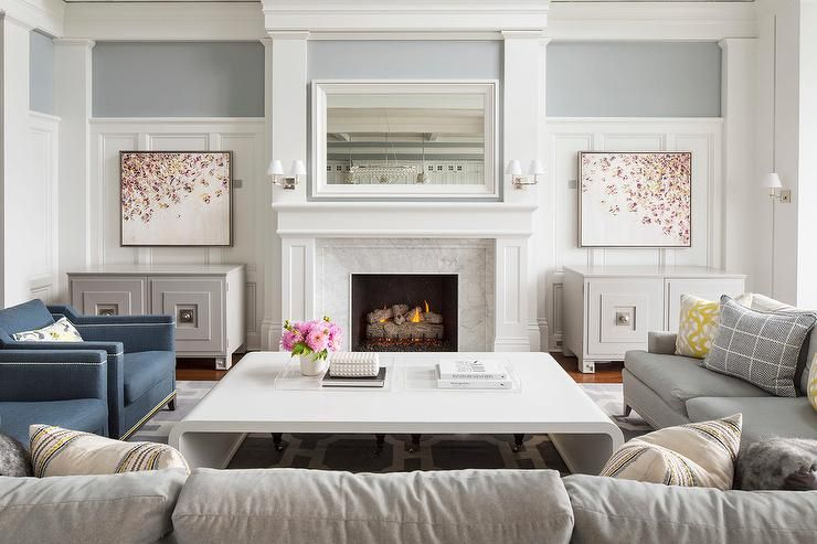 White And Gray Living Room Features Two Sofas A Pair Of Blue Accent Chairs