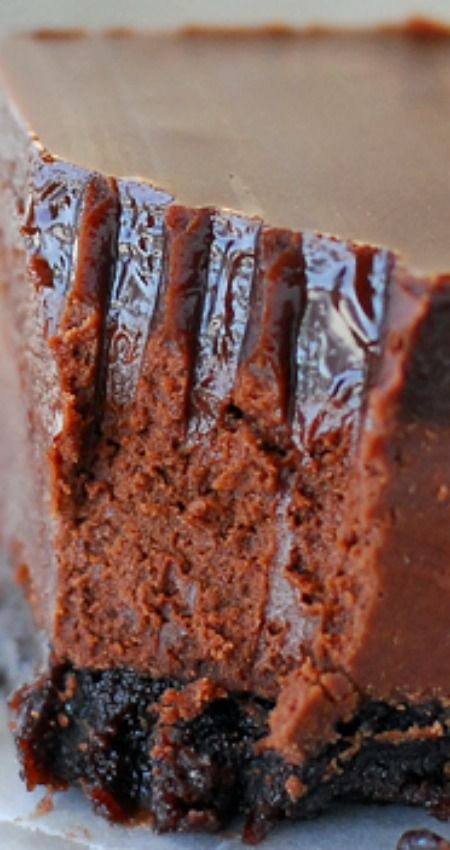 Chocolate Truffle Fudge Bars ~ Melt-in-your-mouth delicious... This triple chocolate bars recipe has a brownie base, a chocolate truffle layer and smooth chocolate frosting on top.