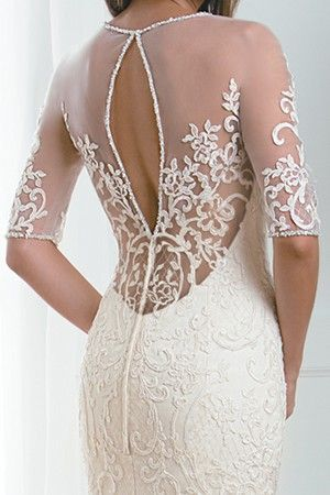 DETAIL DESCRIPTION This dress features an intricately beaded and accented Queen Ann neckline and extravagant Alençon lace over airy layers of organza with a fit and flare skirt. This sexy and extravagant dress will make a statement at any wedding.