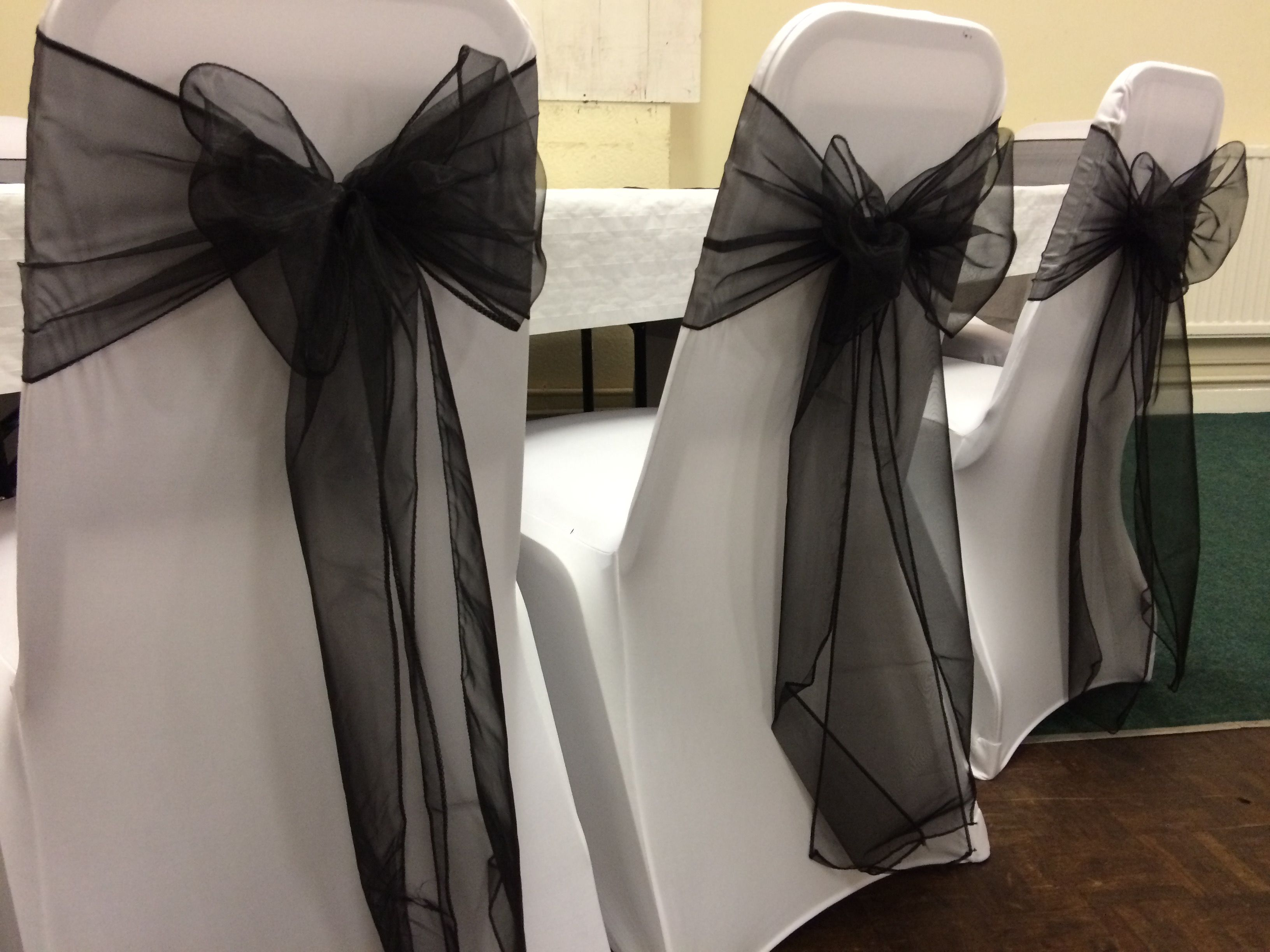 Wedding Chair Covers Swansea Fishing Arm White With Black Organza Sashes At A Dressed By Affinity Event Decorators