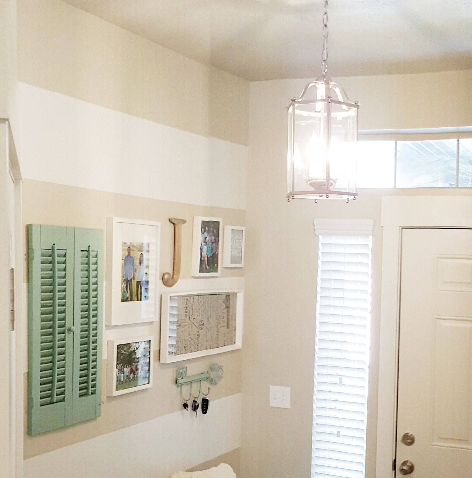 Antique shutter, ikea frames, gallery wall entry, brushed nickel pendant light
