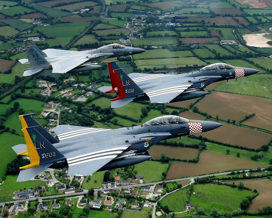 An F15C Eagle and a pair of heritage painted F15E Strike