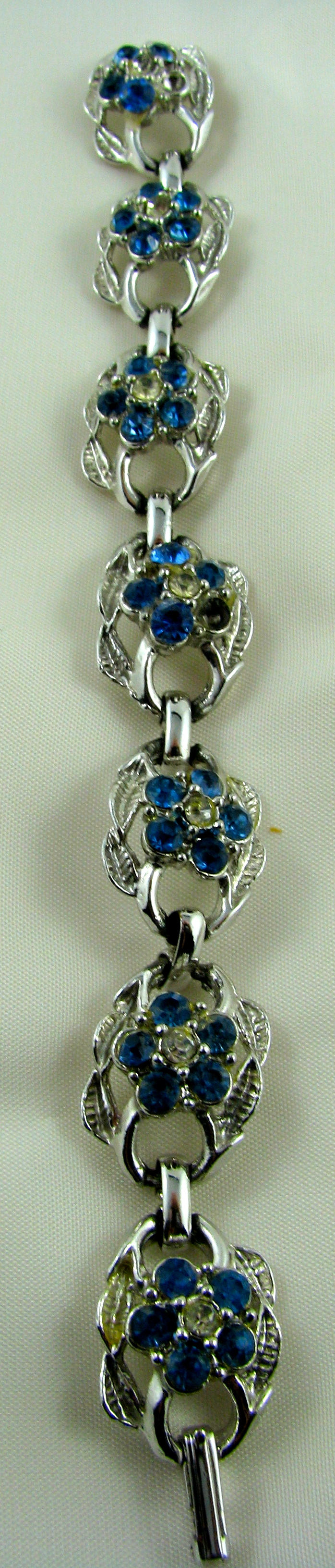 dainty silver coloured with tiny blue stone lovely check my website at  http://vintagecollector.ca/