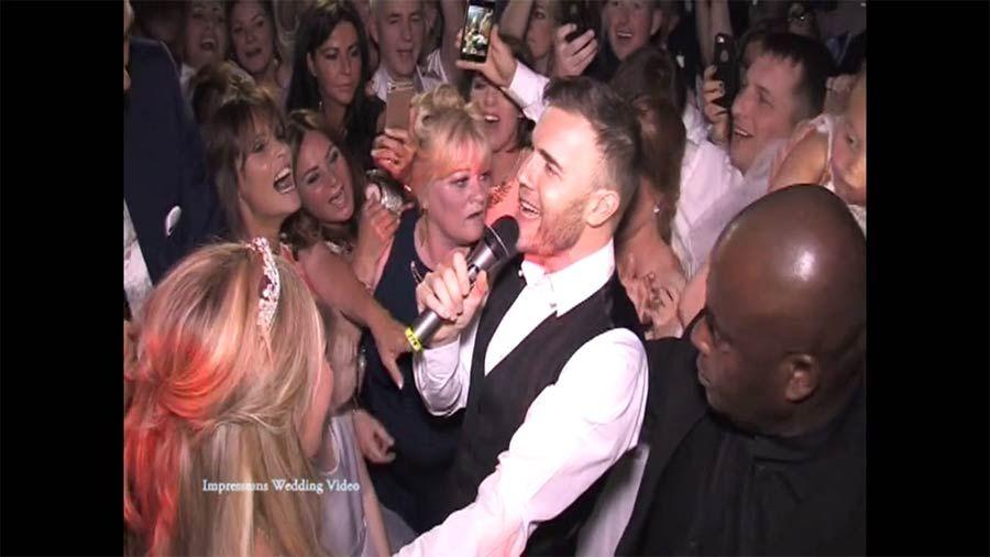 Gary Barlow Serenades Fan During Surprise Wedding Earance