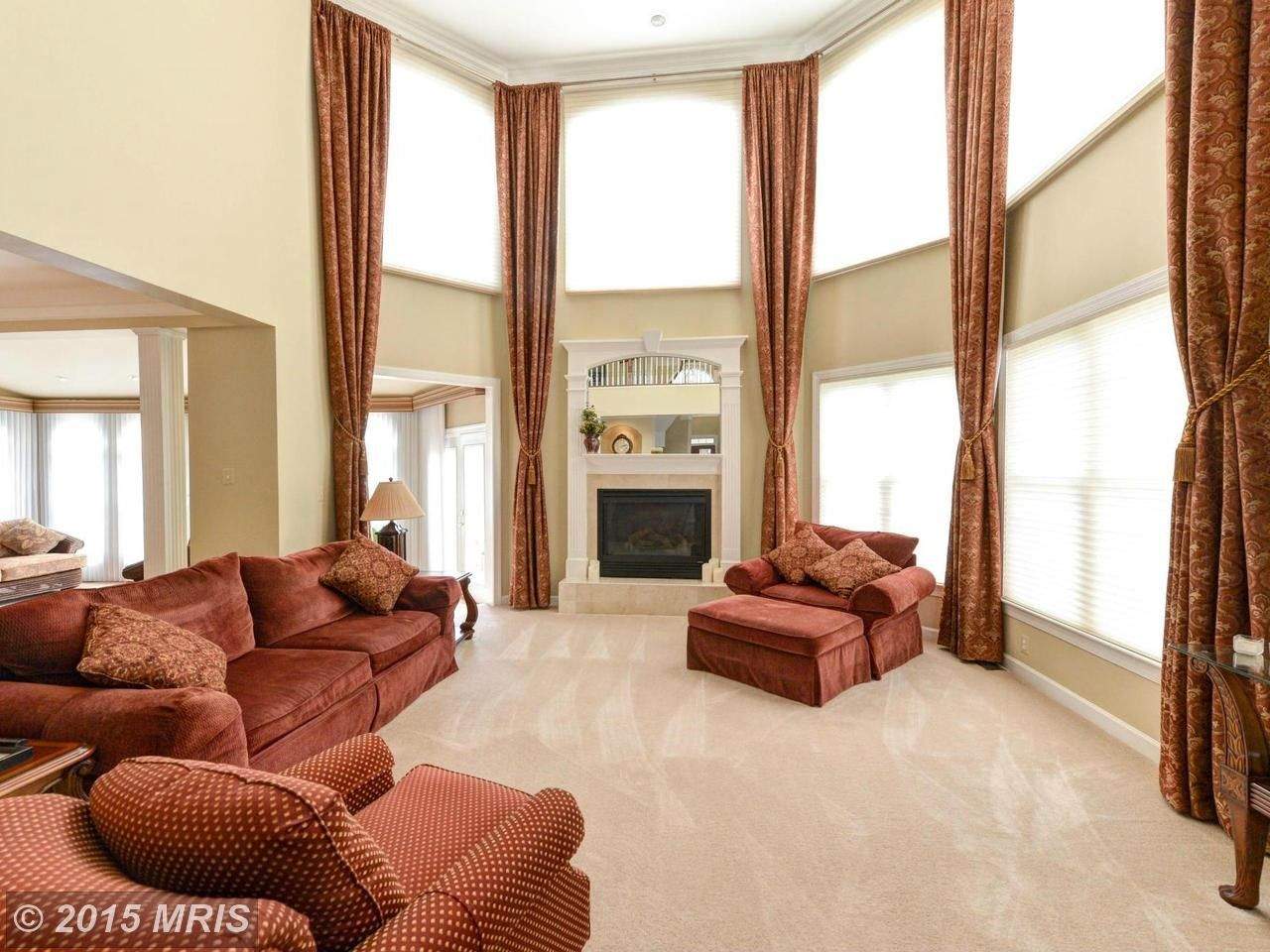 2 Story D Over Motorized Honeycombs In A Family Room