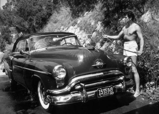 Rock Hudson Washing His Car Outside His Hollywood Home, 1952
