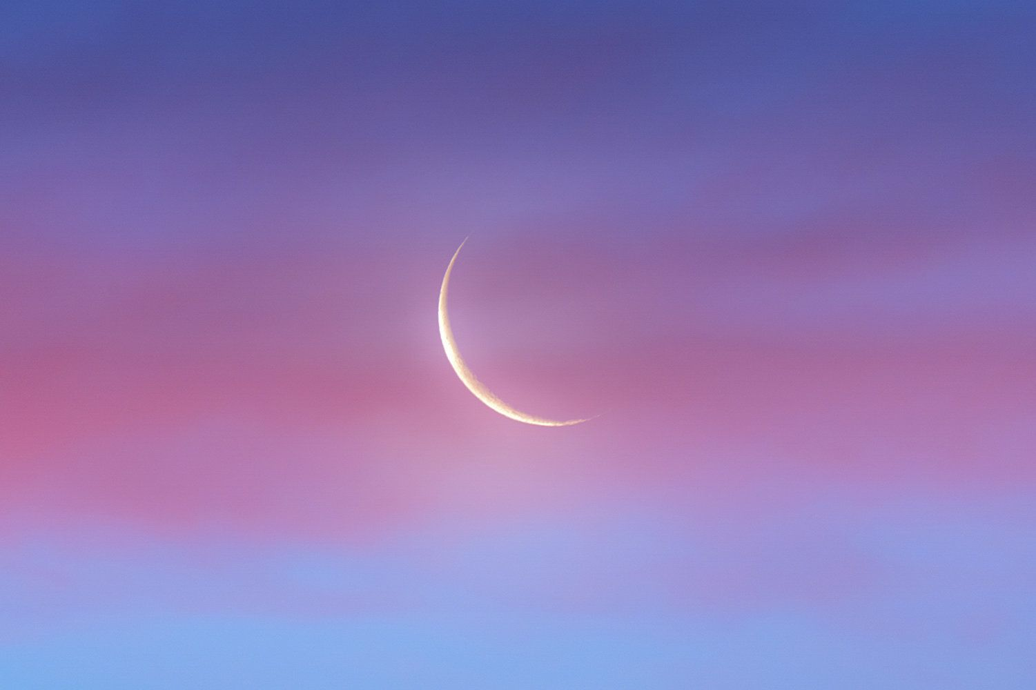 A Waning Crescent Moon Rises At Dawn Against The Glow Of Twilight And Behind A Pink Band Of Clouds Just A Few Minutes Befo Crescent Moon Moon Moon Photography