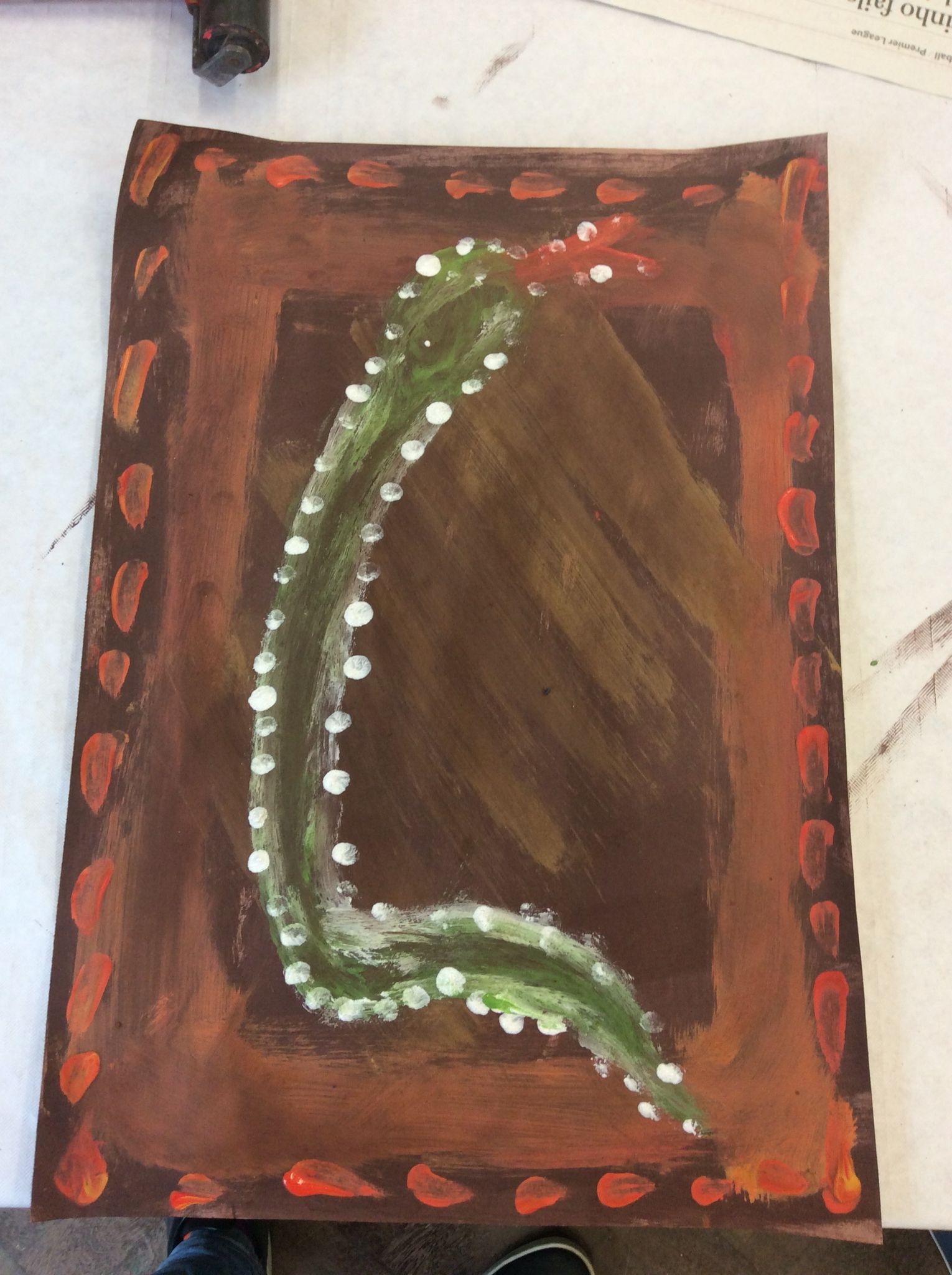 Aboriginal art, using earthy colours, as that would have been available to the aboriginals