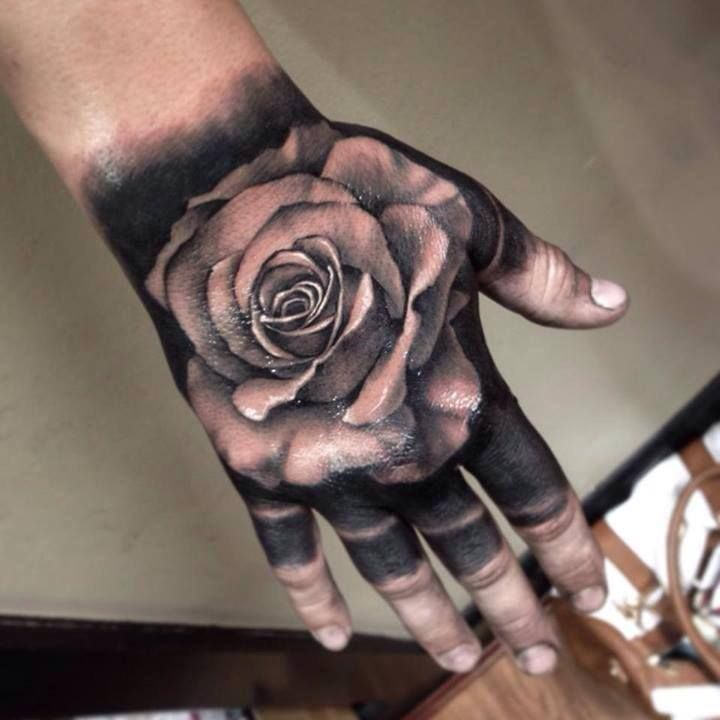Black And Grey Rose Tattoo On Right Hand Hand Tattoos Rose Hand