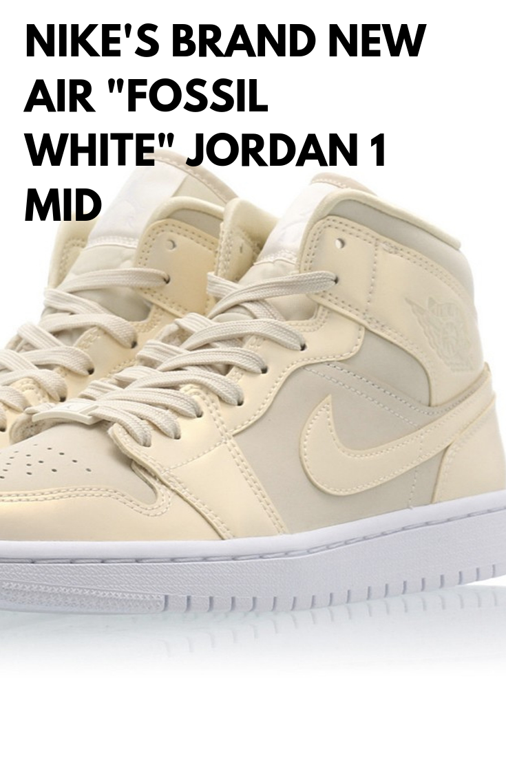 Nike S Air Jordan 1 Mid Returns In A Fossil White With A Shiny Cream Colored Upper Sitting On A Clean White Midsole Ot Air Jordans Jordan 1 Mid Nike Brand