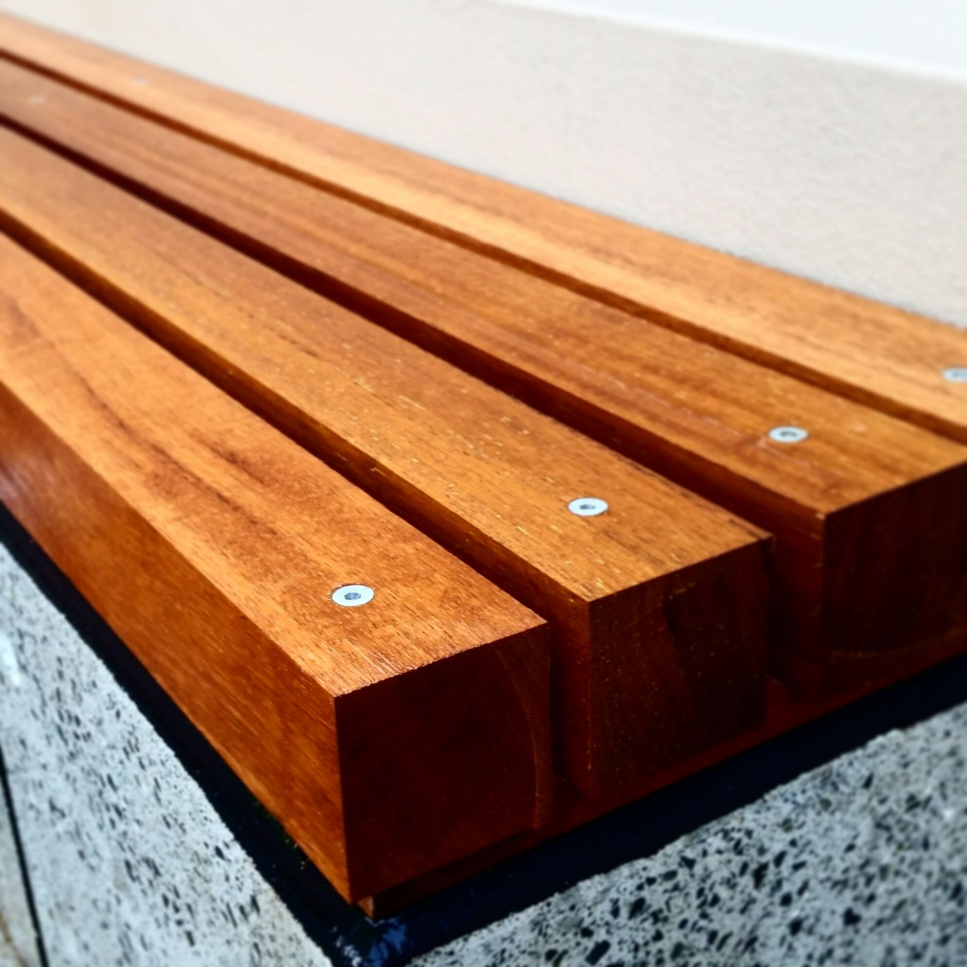 Merbau Timber Posts Fixed To Polished Concrete Bench Seat