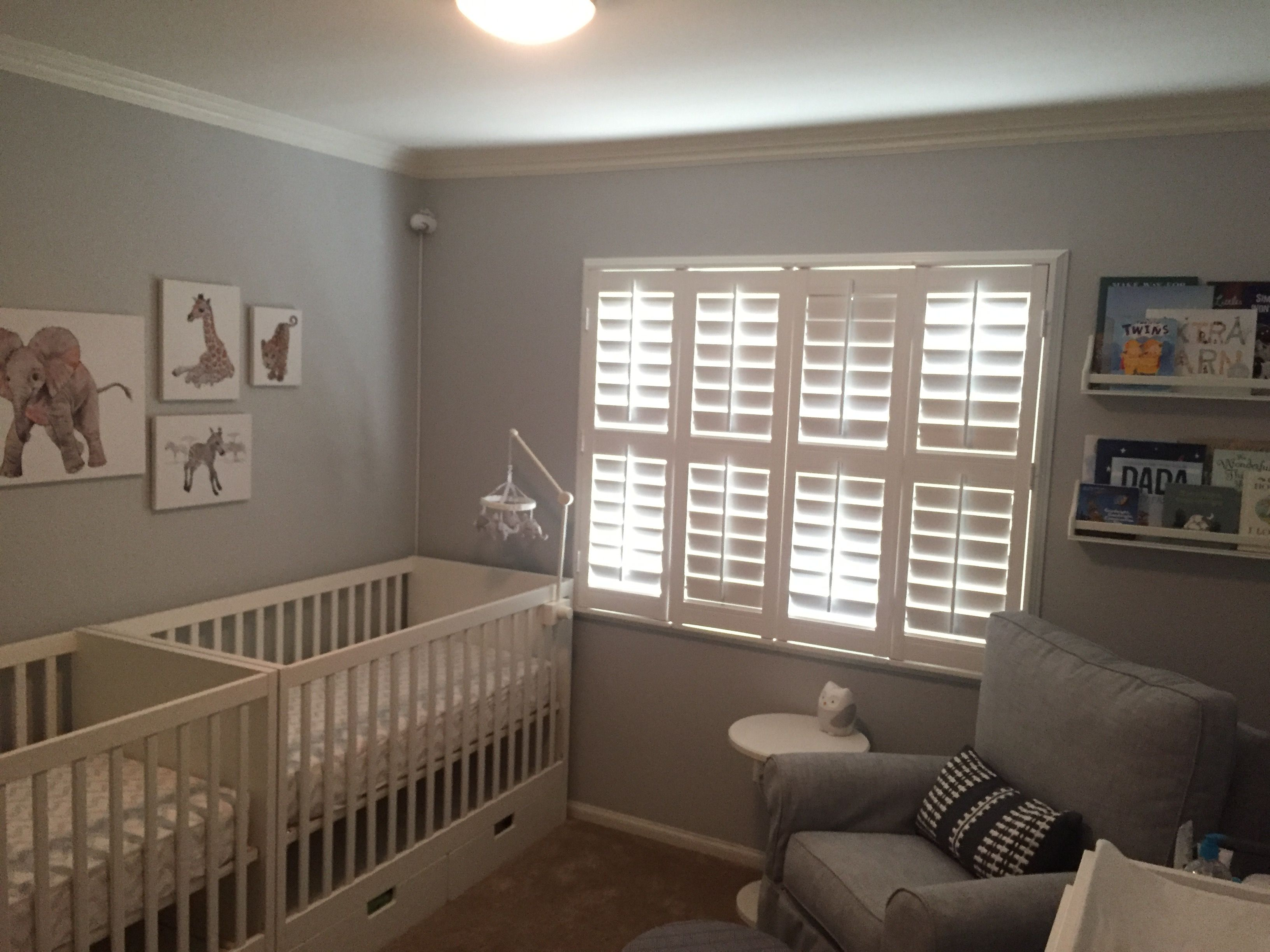 White and grey nursery with baby animal canvas prints
