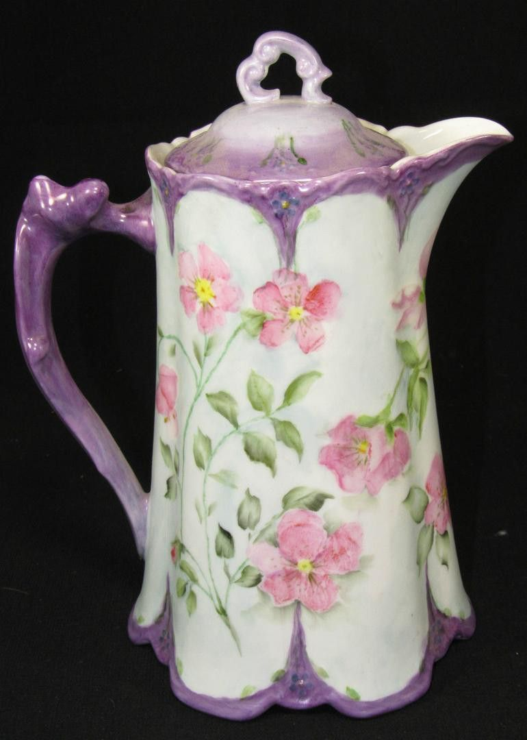 Here is a nice hand painted, artist signed limoges pitcher. 9 3/4 tall. is 7 1/2 wide spout to handle. No chips, cracks or repairs. Looks like it has sat in someone china cabinet all it's life. What