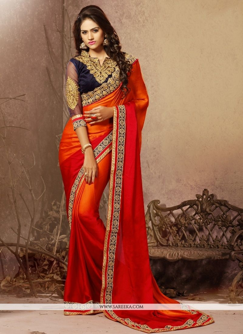 Designed with simplicity with a touch of soberness in its work makes a masterpiece. Be your diverse style and design diva with this red and orange chiffon satin designer saree. The amazing attire crea...