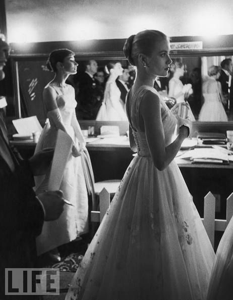 Audrey and Grace: Photo by Allan Grant, 1956  Backstage at the Academy Awards, two past Best Actress winners, Audrey Hepburn and Grace Kelly, await their turns to present.