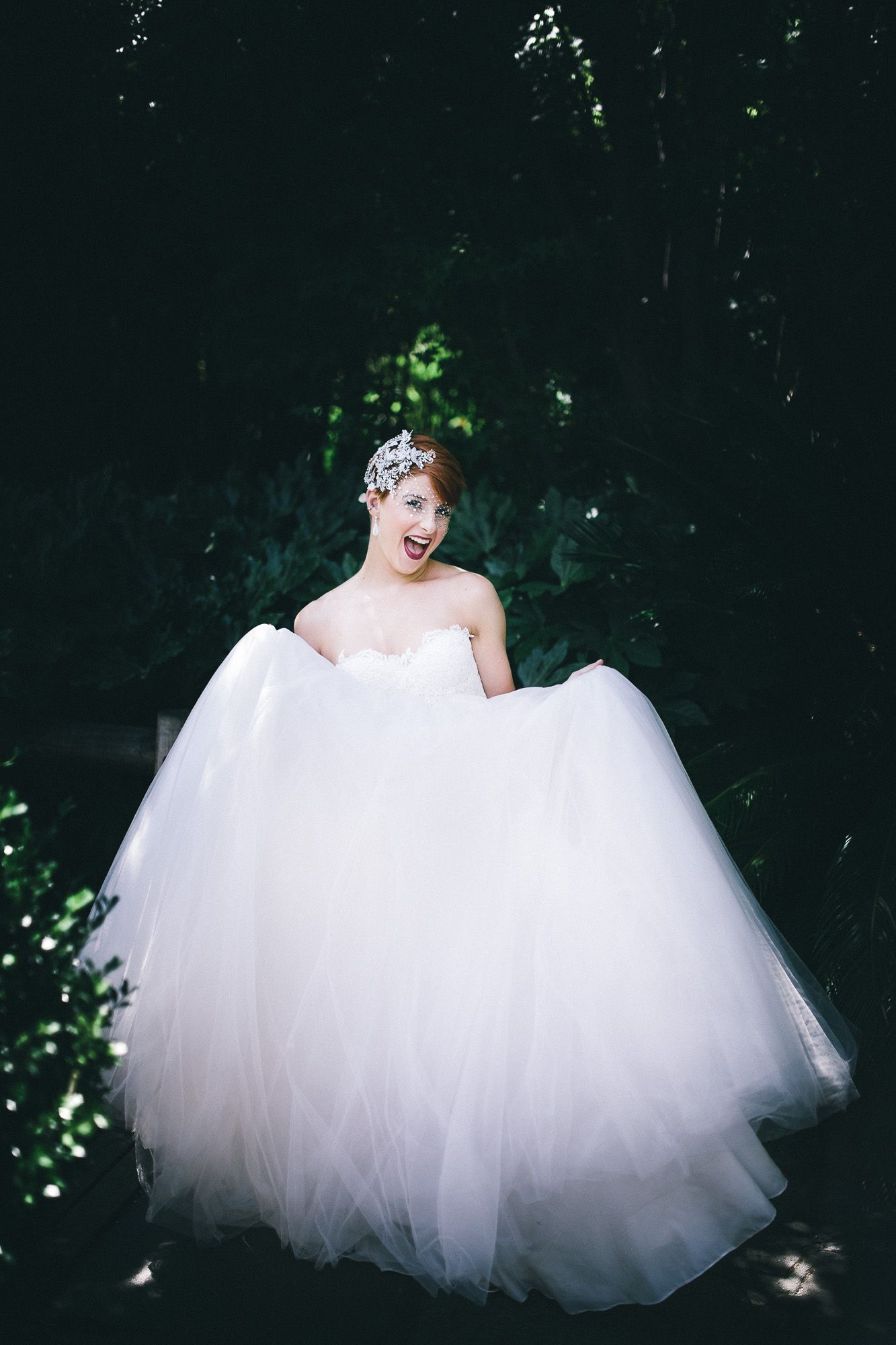 Wedding photography: easy-going bride in gorgeous gown in park