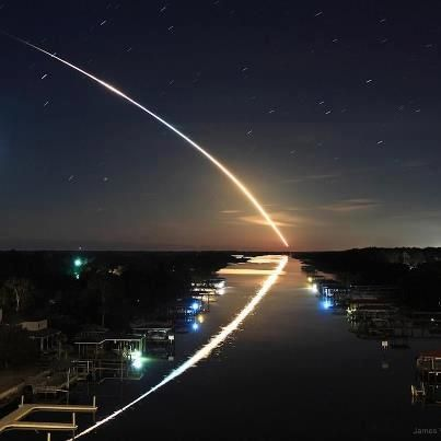 space shuttle launch ..and its reflection